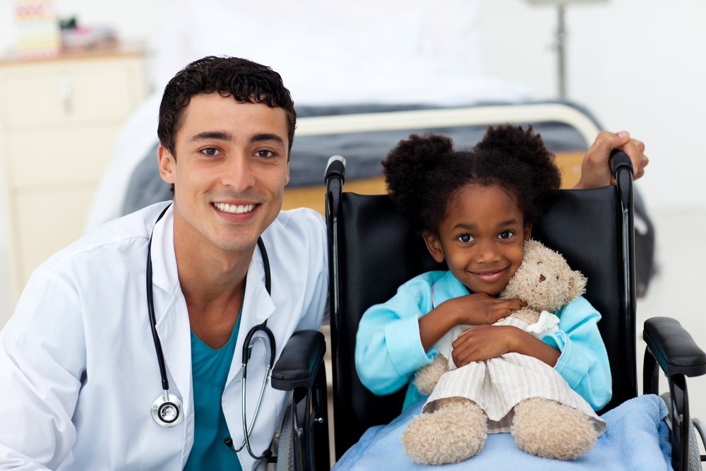 Young child being cared for by a doctor in a hospital.jpeg